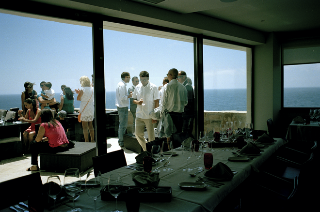 Guests on the balcony of the restaurant captured in film